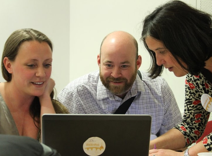 Holly Taylor, Dom Newton and Liz Newton at laptop